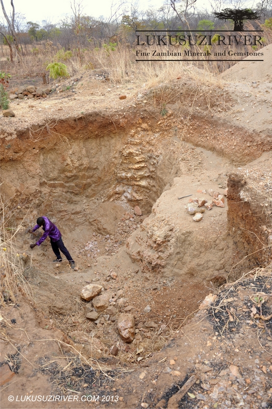 Magodi: The pegmatite was discovered during farming and the pits were dug by Mr. Mbusi on his own.