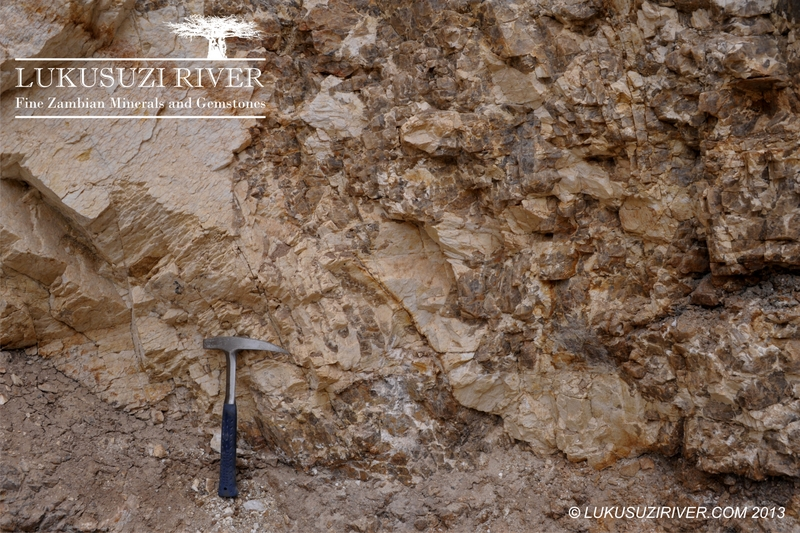 Typical pegmatite texture with coarse feldspar (lighter) and quartz (darker).